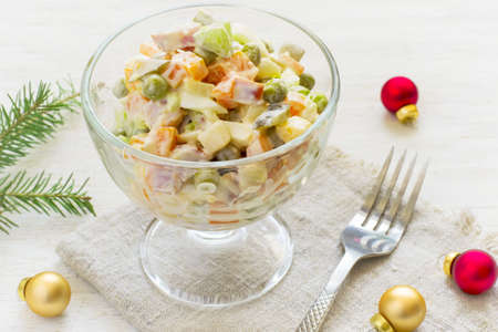 Traditional New Years Russian salad Olivier on a white background