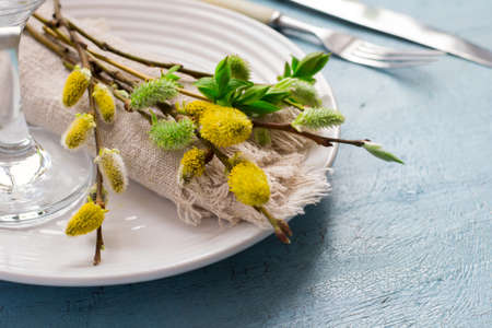 grunge cutlery: Spring Easter Table setting on a blue wooden table.