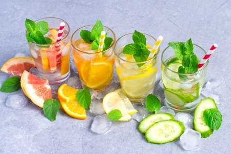 infusing: Set of infused water for detox on a gray background Stock Photo