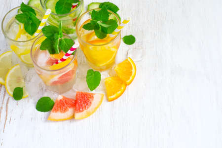 infusing: Set of infused water for detox on a white background