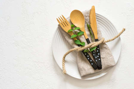 Natural table setting with bamboo knife fork and spoon, Top view with copy space Stock Photo