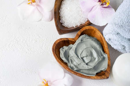 Cosmetic face and body mask of blue clay. Spa setting. Top view with copy space