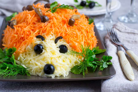 colorful salad is decorated in the form of a hedgehog. idea for childrens menu. Selective focus