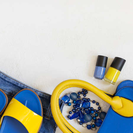 flat lay Female clothing and accessories in bright yellow blue summer tones. Top view with copy space Reklamní fotografie