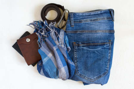 Flat lay Set of casual male clothes on a white background. Top view