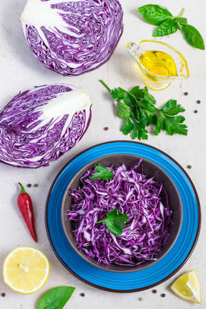 nourishing: Purple cabbage salad in bowl And ingredients on white background. Top view