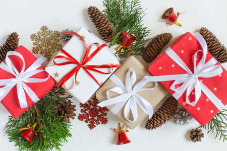 festive decorated christmas gift boxes and decor are in line on a white background top