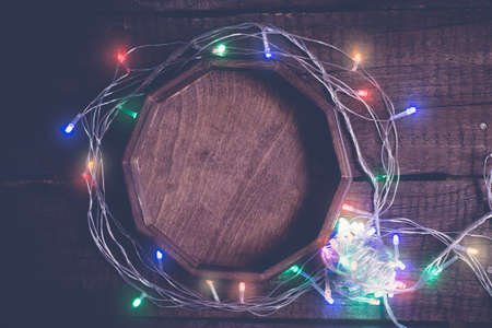 Cozy christmas Vintage background. Multicolored electric garland