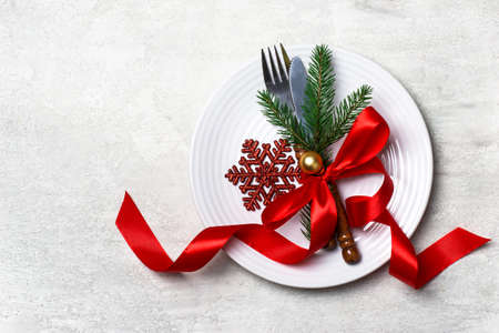 Christmas table setting with Christmas decorations  on white