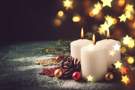 Christmas card with burning candles and decorations. Stock Photo