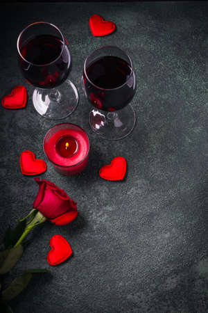 Valentines day greeting card concept. Wine glasses, rose and candle.