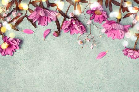 Spring Summer Creative nature background. Pink flowers border on vintage blue background.