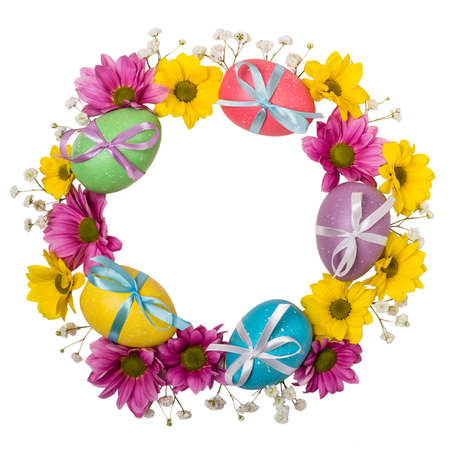 Colorful wreath of Easter eggs and flowers isolated on white background.