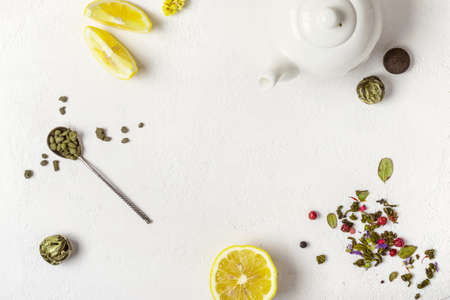 Tea concept. Selection of different varieties of tea and white teapot Stock Photo