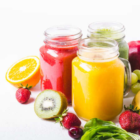 Selection of multicolored fruit smoothies  in glass jars. Healthy Food detox Concept Zdjęcie Seryjne
