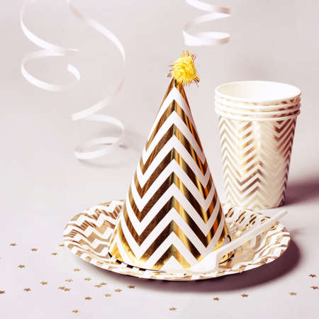 Golden striped cone hat and other party accessories.