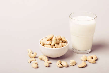 Cashew nut non diary milk and nuts. Health care and diet concept. Stock Photo