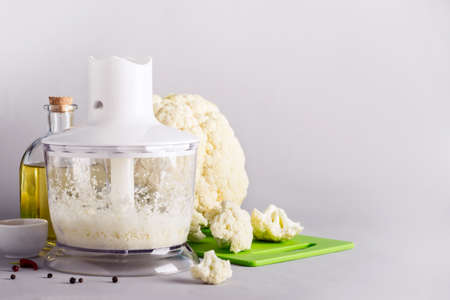 Cooking cauliflower rice in a blender, copy space. Stock fotó