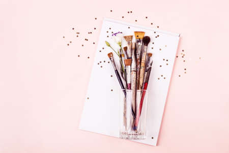 Art Brush Set, drawing album and gold stars on pink pastel background. Creativity Concept.