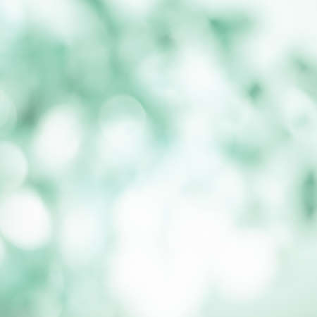 Green bokeh lights background. Abstract blurred light spots.