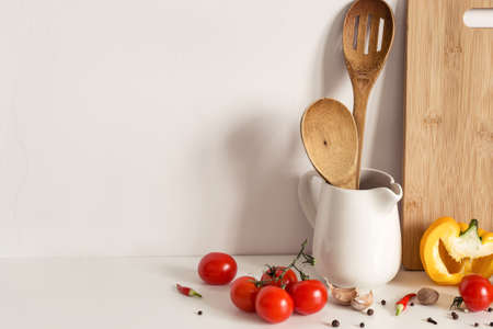 Wooden Kitchenware, vegetables and spices on table wall Imagens