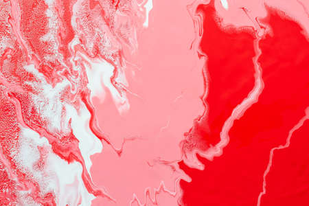 Acrylic Fluid Art. Pink and red waves and whites inclusion. Abstract marble background or texture.