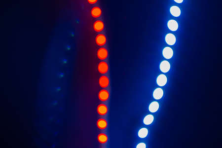 Red and blue blurry neon bokeh lights on black. Abstract background of 80s colors. Reklamní fotografie