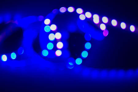 Violet and blue neon blurry swirl of bokeh led lights on black. Abstract night party background. Reklamní fotografie