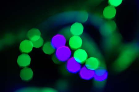 Blurred duotone bokeh lights spiral on black. Abstract background for your design. Reklamní fotografie