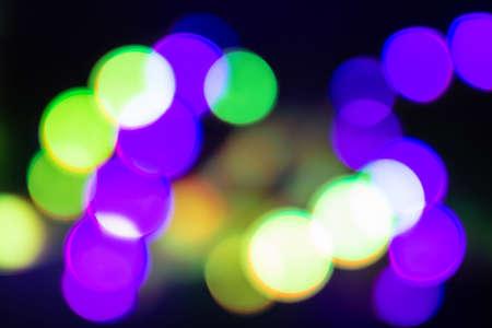 Duotone green and purple blurry neon lights on black. Reklamní fotografie