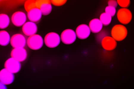 Duotone Red and purple neon lights on black. Abstract background for your design.