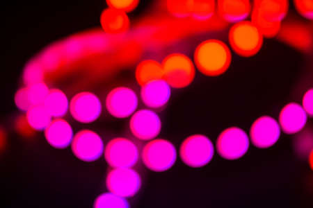 Duotone Red and purple neon lights on black. Abstract night blurred background. Reklamní fotografie