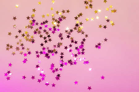 Holographic confetti stars on pink neon