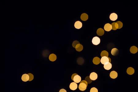 Gold bokeh lights shine. Black festive Reklamní fotografie