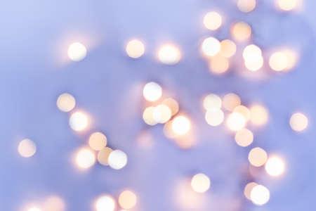 Golden festive bokeh lights on blue