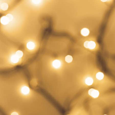 Golden festive bokeh lights on blurred