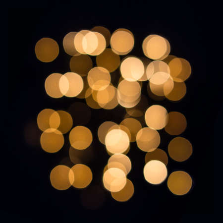 Golden bokeh lights Abstraction of hexagonal shape on black square. Poster for your interior.