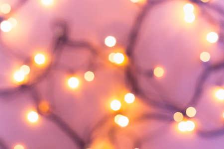 Christmas or party concept. Golden bokeh lights on blurred pink Reklamní fotografie