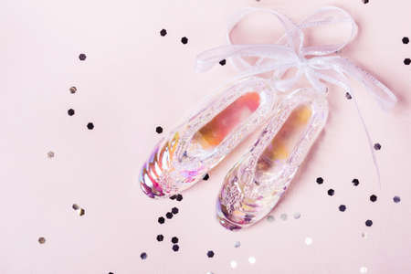Pointer shoes made of transparent holographic glass. Christmas concept.