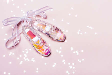 Transparent Holographic Christmas Toy Pointer Shoes and sparkle confetti. Christmas concept.