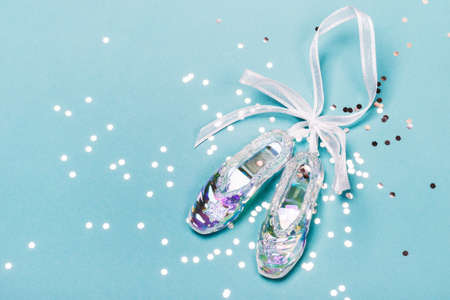 Transparent Christmas Toy Pointer Shoes and silver confetti. Christmas concept.