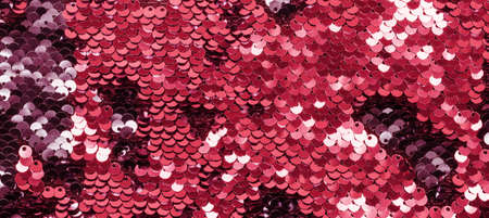Shining Coral sequins on fabric. Imagens