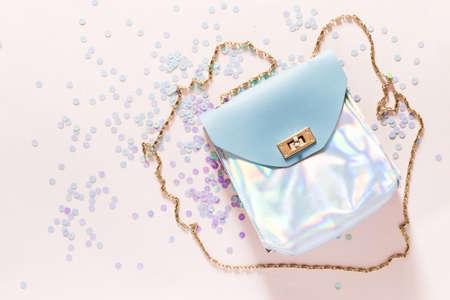 Holographic handbag with gold chain handle on pink