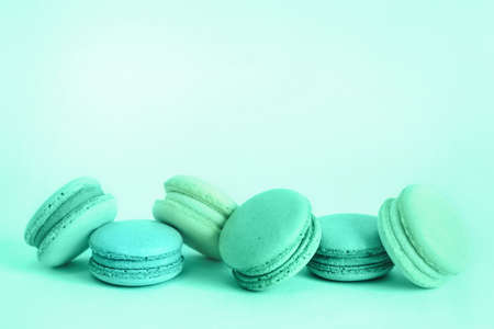 French macaroons cookies set in trendy green colors. Holidays food concept with copy space.