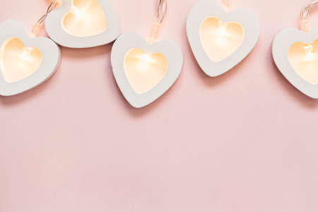 Valentine's day or hen party decoration. Romantic pink  with heart garland border.