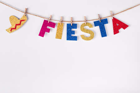 DIY paper Garland made of Fiesta word and sombrero.