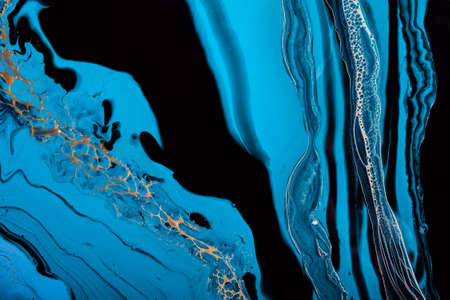 Acrylic Fluid Art. Blue colors waves in abstract ocean and golden foamy waves. Marble effect background or texture.
