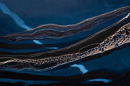 Acrylic Fluid Art. Dark Blue waves in abstract ocean and golden foamy waves. Marble effect background or texture