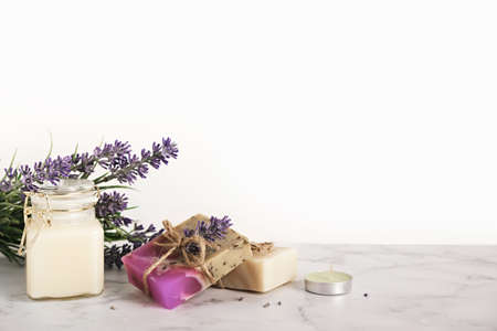 Lavender cosmetics products and flowers. Home body skin care, set of bathroom accessories