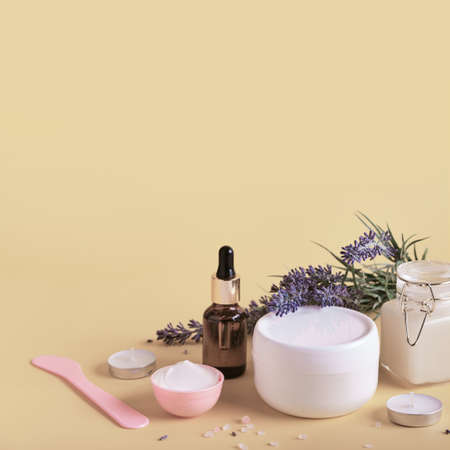 Natural cosmetics products with lavender. Home body skin care. Spa setting in neutral colors
